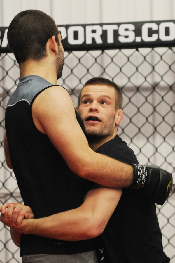 Mixed martial arts fighter Ryan Sanders (right) trains with Nash Roy at Young's MMA in Bangor on Thursday.