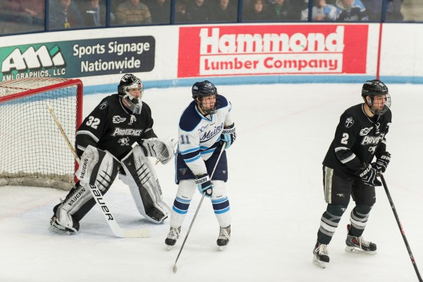 The University of Maine's Steven Swavely prepares for a pass against Providence College goalie Jon Gillies of  South Portland and defenseman Kevin Hart at Alfond Arena on Feb. 28.
