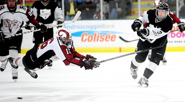 Bangor's Justin Courtney tries to get in front of a pass from St. Dominic's Chase Hainey in the third period at the Androscoggin Bank Colisee in Lewiston on Tuesday, March 4. The Saints topped the Rams 3-1 in the Eastern Class A final.