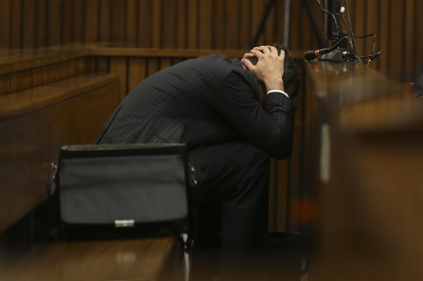 Olympic and Paralympic track star Oscar Pistorius reacts in the dock during his trial for the murder of his girlfriend Reeva Steenkamp, at the North Gauteng High Court in Pretoria, South Africa, on Monday.