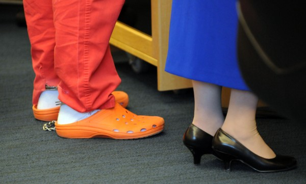 The feet of  Dorian Christian Sky Guerin are chained as he stands with defense attorney Martha Harris during his appearance at the Penobscot Judicial Center in Bangor on Tuesday.