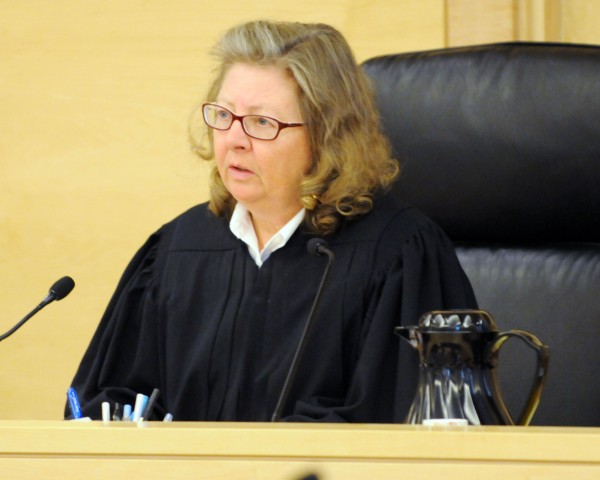 Superior Court Justice Ann Murray presides over Dorian Christian Sky Guerin's appearance at the Penobscot Judicial Center in Bangor on Tuesday. Guerin is being charged in connection with the stabbing of his mother's boyfriend.