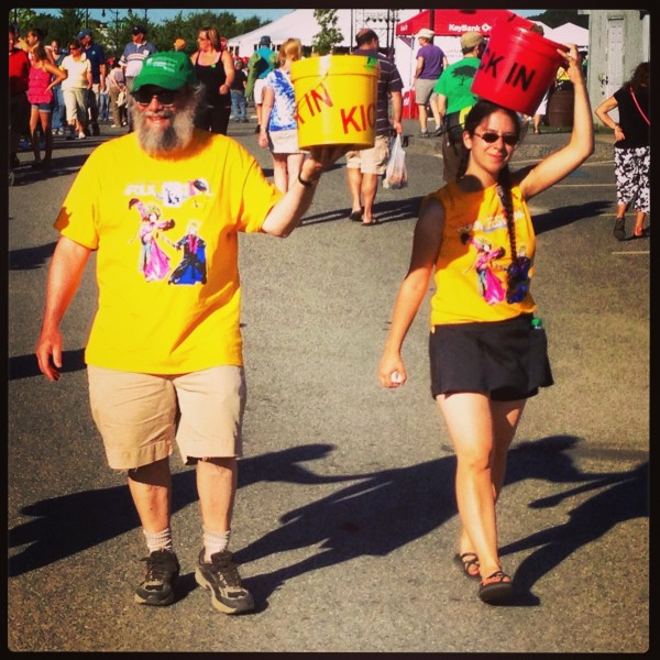 Volunteers with the Bucket Brigade walk around collecting donations during the 2013 American Folk Festival on the Bangor Waterfront.