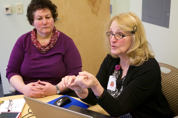 Theresa Grainger (left) of Limington, searches for Affordable Care Act health coverage with certified marketplace navigator Kate Albert in South Portland on Monday, the deadline to sign up.