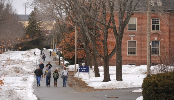 Students walk across campus at the University of Maine in Orono on Monday.