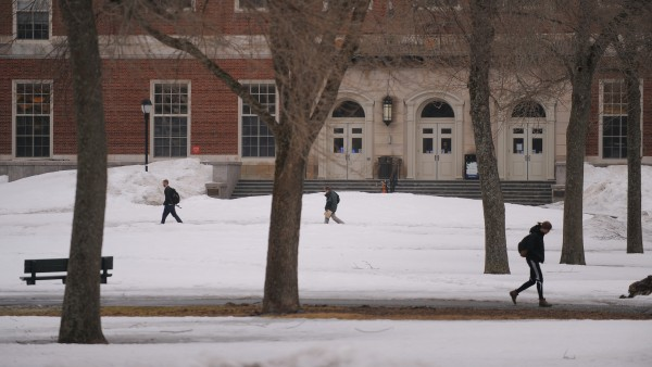 Students walk the University of Maine campus in Orono on Monday.