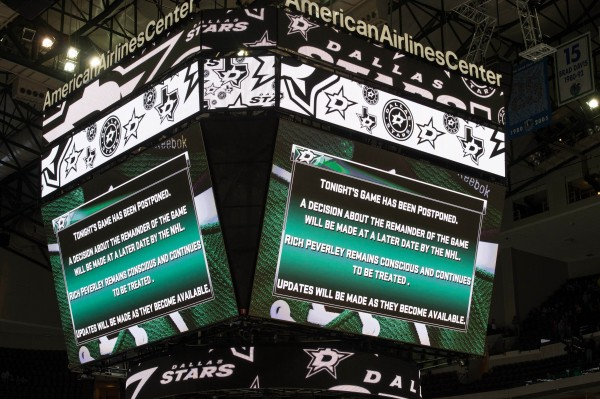 A view of the scoreboard after the game between the Dallas Stars and the Columbus Blue Jackets was postponed during the first period due to center Rich Peverley collapsing on the bench at the American Airlines Center in Dallas Monday night.