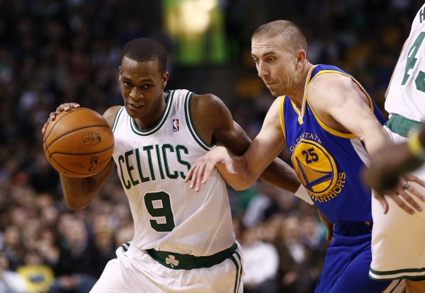 Boston Celtics point guard Rajon Rondo (9) drives to the hoop against Golden State's Steve Blake (25) during the second half of Wednesday's NBA game at TD Garden in Bangor. The Warriors won 108-88.