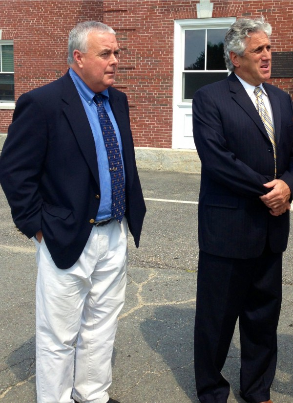 Donald Hill, left, stands with defense attorney Gary Prolman outside the York County courthouse in Alfred on Aug. 20, 2013. Hill, former Kennebunk High School hockey coach, was acquitted of the charge of engaging a prostitute