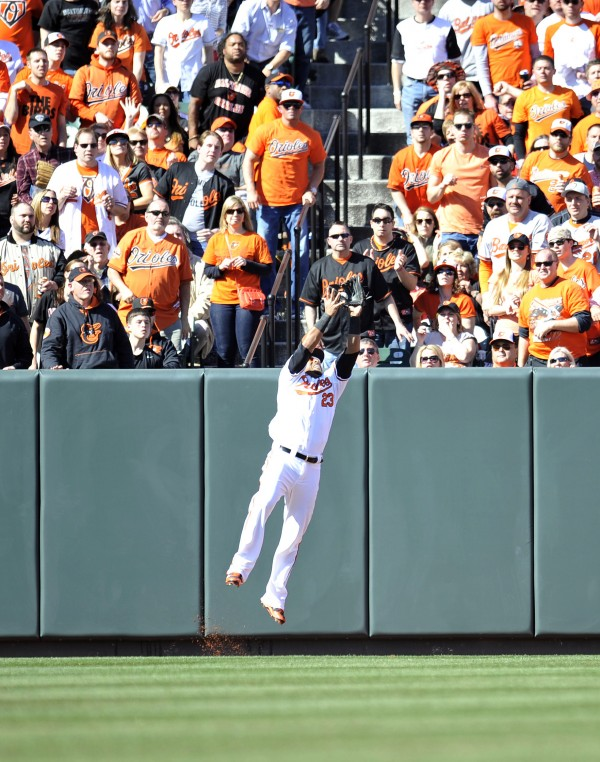 Baltimore Orioles left fielder Nelson Cruz (23) catches a pop-up by Boston Red Sox shortstop Xander Bogaerts (not pictured) in the second inning of an opening day baseball game at Oriole Park at Camden Yards.