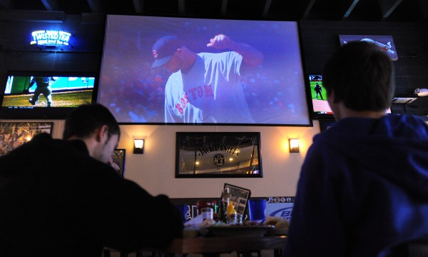 Nicholas Wirta, left, and his brother Dan Wirta watch the Boston Red Sox's season-opener against the Baltimore Orioles Monday at Hero's Sports Grill & Entertainment Center in Bangor Monday.