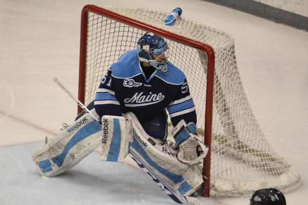 Maine goalie Martin Ouellette watches the puck during Hockey East quarterfinal action against Providence College Friday night at Schneider Arena in Providence, R.I.