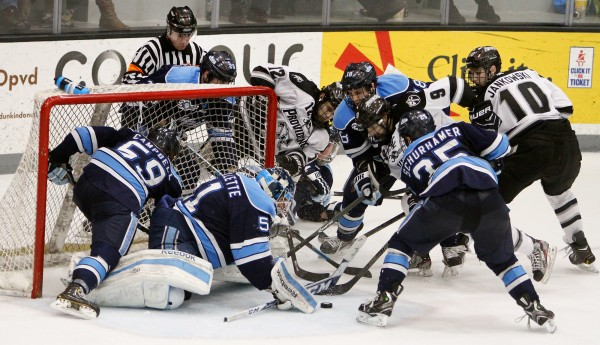 Maine's Brady Campbell (59), Eric Schurhamer (25) and Jon Swavely try to help out goalie Martin Ouellette as Providence's Mark Jankowski eyes the puck in the  second period during Hockey East playoff action Friday night in Providence, R.I.