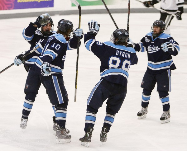 Maine's Ben Hutton (10), celebrates with teammates after scoring in the second period against Providence during Hockey East playoff action Friday night in Providence, R.I.  Providence won 3-1.