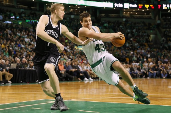 Boston Celtics center Kris Humphries (43) tries to drive around Brooklyn Nets power forward Mason Plumlee (1) during the second half of Boston's 91-84 win at TD Garden in Boston Friday night.