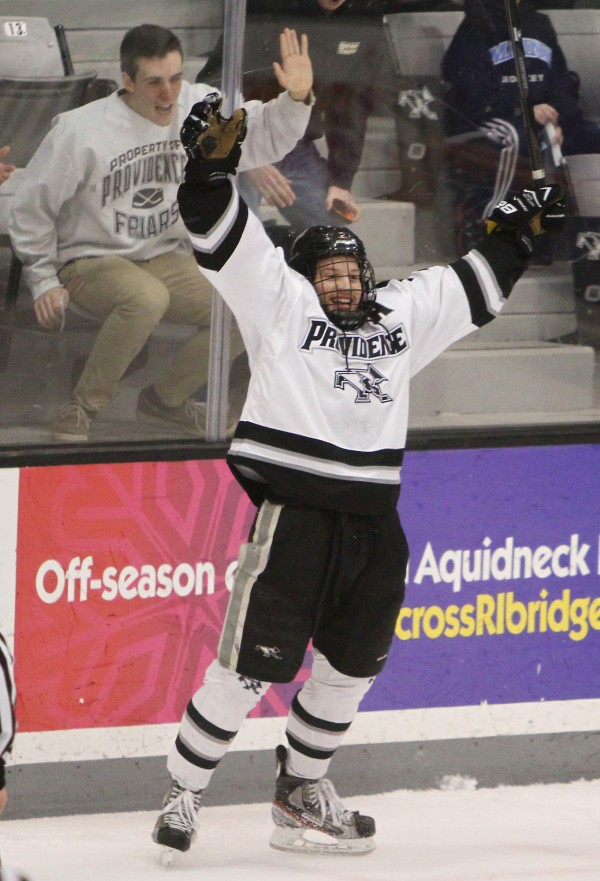 Matt Christie of North Smithfield, R.I., pounds on the glass as he helps Derek Army of Providence College celebrate the Friars second goal of the first period against Maine in Hockey East playoff action Friday night in Providence, R.I.