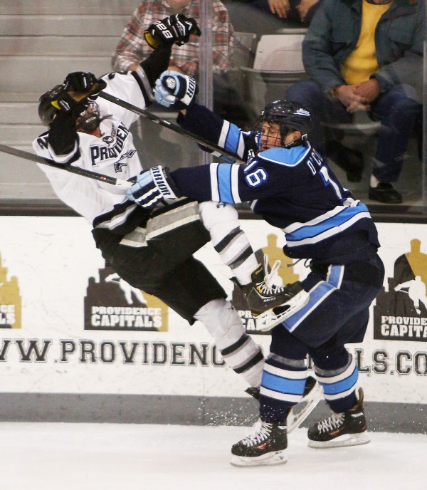 Maine's Brice O'Connor (right) knocks Providence College's Brandon Tanev to the ice in first-period action of their Hockey East series opener Friday night in Providence, R.I. Providence won 3-1.