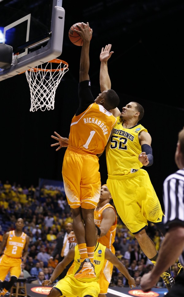 Tennessee Volunteers guard Josh Richardson (1) tries to dunk past Michigan Wolverines forward Jordan Morgan (52). Tennessee lost to Michigan 73-71 in the Midwest Regional Friday in Indianapolis