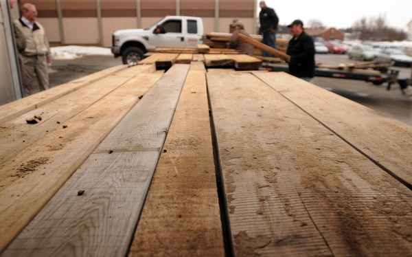 Timber that was submerged in Quakish Lake in Millinocket since the early 1800s comes out of a kiln at the University of Maine on Wednesday.