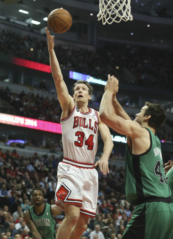 Chicago Bulls forward Mike Dunleavy goes to the basket against Boston Celtics center Kris Humphries during the first half at the United Center in Chicago on Monday night.