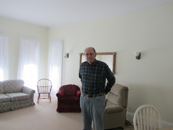 The Talbot Home board Vice President Charles Heald stands inside the Rockland home.