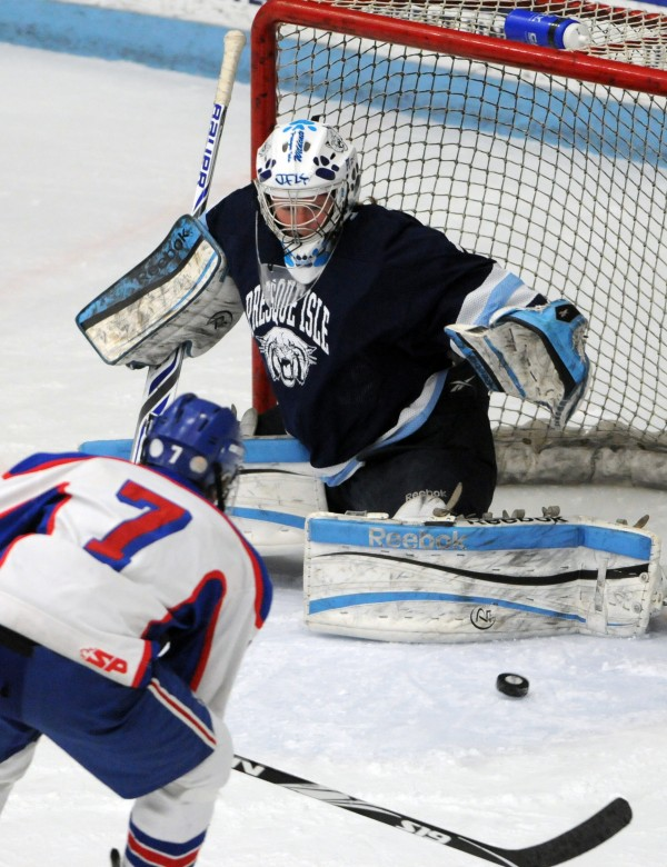 Presque Isle goalie Jillian Flynn stops a shot on goal by Messalonskee's Jacob Dexter during first-period action during the Class B East final Tuesday night at Alfond Arena.