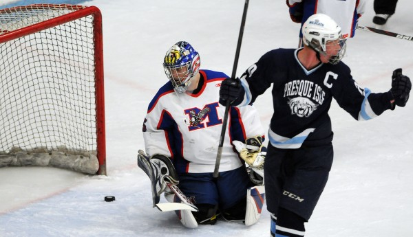 Presque Isle's Tyler Seeley celebrates his goal against Messalonskee as goalie Benjamin Weeks stares at the puck as it slides out of the net during first period action of the East Class B final Tuesday night at Alfond Arena.