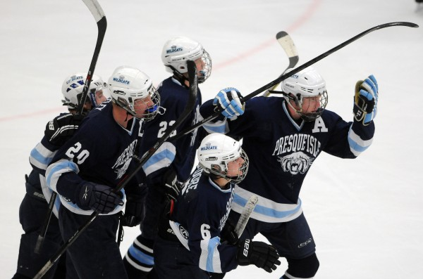 Members of Presque Isle hockey team celebrates their first goal against Messalonskee during first-period action of the East Class B final Tuesday night at Alfond Arena.
