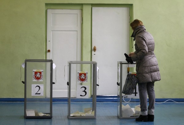 A woman casts her ballot during the referendum on the status of Ukraine's Crimea region at a polling station in Simferopol, Ukraine, on Sunday.