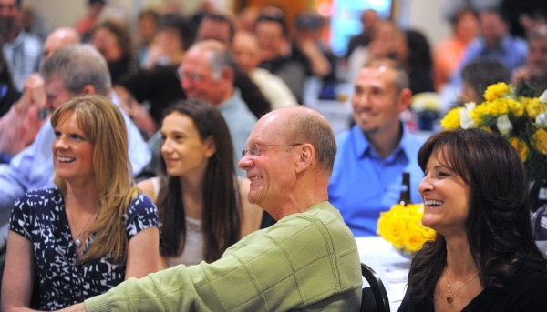 Former Bangor Police Chief Don Winslow (center) shares a laugh with his daughter Melissa Winslow Garcia (left) and event organizer Corenna O'Brien (right) during a benefit dinner Saturday night at Jeff's Catering in Brewer. Winslow is battling lung cancer.