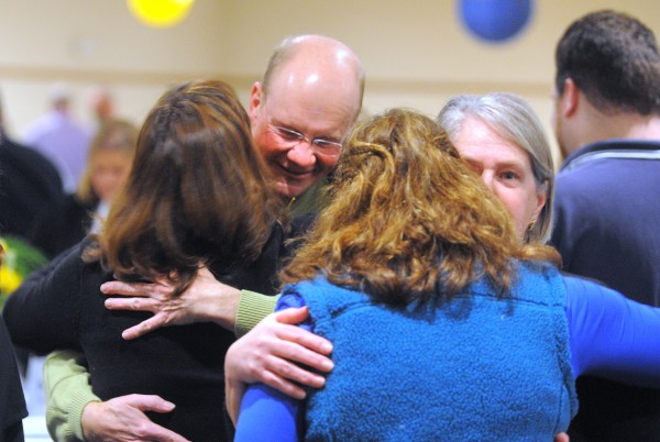 Don Winslow and his wife Dora get huggs of support during a benefit dinner Saturday night at Jeff's Catering in Brewer.  Former Bangor Police Chief Don Winslow is battling lung cancer.