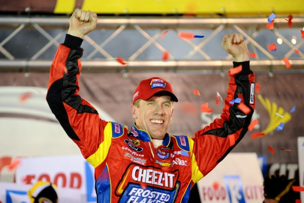 NASCAR Sprint Cup Series driver Carl Edwards celebrates after winning the Food City 500 at Bristol Motor Speedway Sunday night.