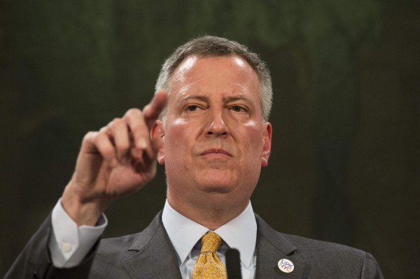 New York Mayor Bill de Blasio answers questions during a news conference at City Hall in New York March 11, 2014.