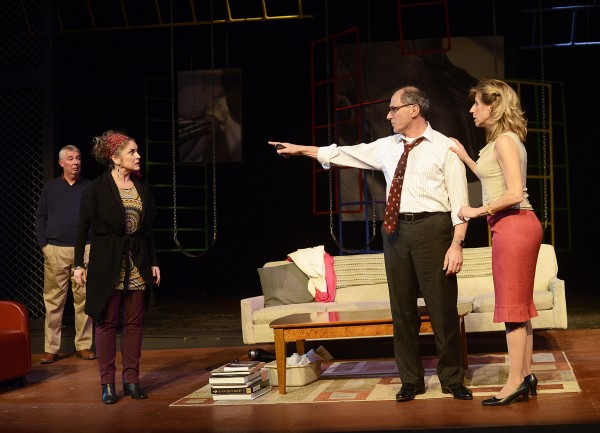 Mark Torres as Alan and Jeri Misler as Annette (right) discuss with Bernard Hope as Michael and A.J. Mooney as Vernonica (left) a playground confrontation between their sons in Penobscot Theatre Company's &quotGod of Carnage.&quot The play will be performed through March 30 at the Bangor Opera House.