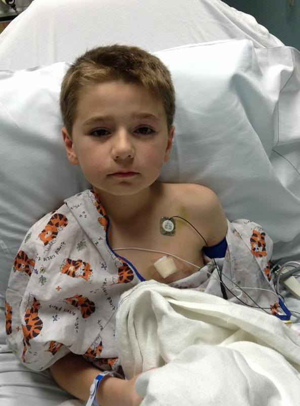 Colby Scott of Bridgewater was 8-years-old when he was diagnosed with aplastic anemia, a condition in which the bone marrow does not make enough new blood cells. He received a bone marrow donation from his younger brother, Carson, which saved his life. He is pictured here in Floating Hospital for Children at Tufts Medical Center in Aug. 2013.