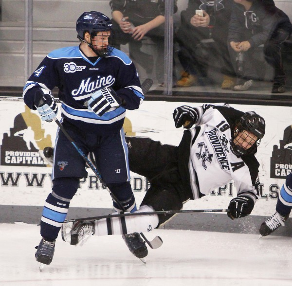 Maine's Jake Rutt (left) knocks Providence College's Derek Army to the ice in the second period of their Hockey East playoff game Friday night in Providence, R.I. Providence won 3-1 and ended Maine's season with a 4-2 victory Saturday. Rutt has been named an assistant captain for the Bears' 2014-15 team.