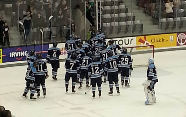 Members of the University of Maine hockey team give a salute to their fans after being beat by Providence College 4-2 in their Hockey East quarterfinal series Saturday night at Schneider Arena in Providence, R.I.