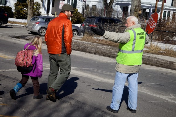 A crossing guard does his duty in from of Longfellow Elementary School in Portland on Monday. Portland Board of Public Education Chairwoman Sarah Thompson gave the annual &quotstate of the schools&quot report to the city council Monday night.