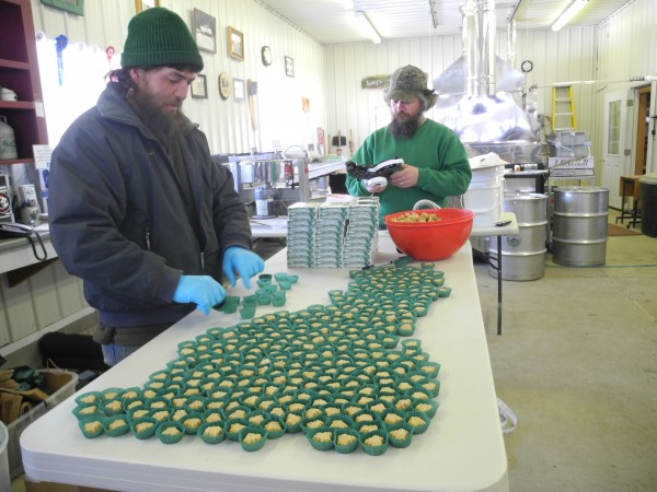 Paul Poulin, left, and his brother, Richard, pack molded maple candies to get ready for sale Friday afternoon at Kinney's Sugarhouse on the Abbott Road in Knox. Workers at the large maple products operation are doing other tasks while waiting for the sap to start flowing from the trees.