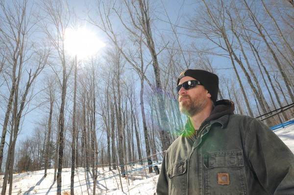 Lee Kinney poses with part of his 185 acre sugarbush at Kinney's Sugarhouse in Knox on Monday. Gov. Paul LePage believes that Maine's maple syrup industry could become a national leader. &quotWe have the trees and the resources. It's a matter of getting more people involved in the industry,&quot LePage said earlier this month.
