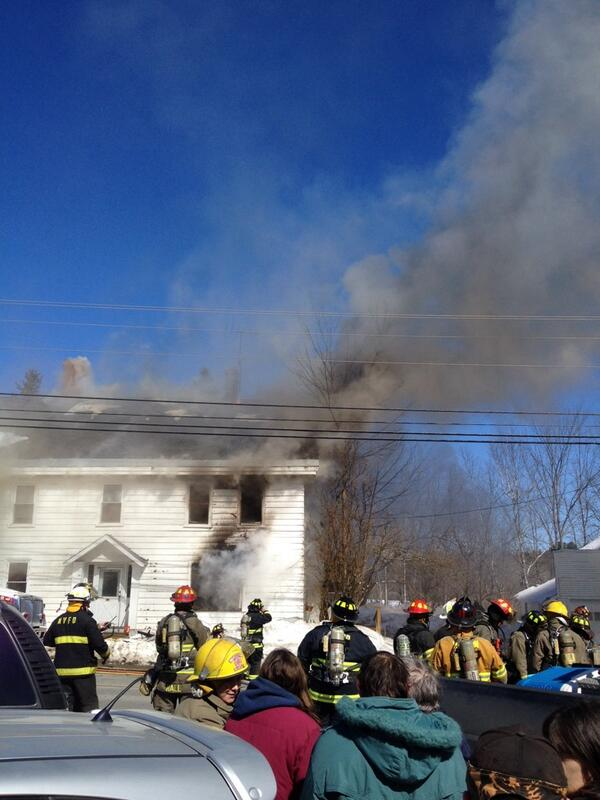 Crews at the scene of a house fire on Route 2 in Carmel on Tuesday.