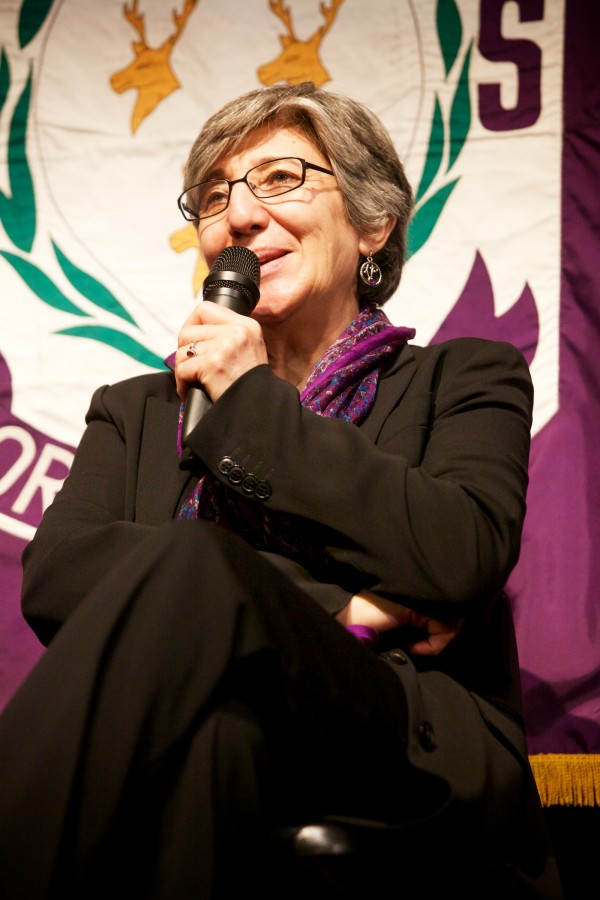 Dr. Sima Samar, a renowned Afghan human rights and women's rights advocate, speaks on a panel in the auditorium at Deering High School in Portland on Tuesday. Samar is in Maine as part of the Justice for Women Lecture Series hosted by the University of Maine School of Law.