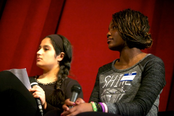 Deering High School students Neilab Habibzai (left) and Aubine Ntibandetse listen to renowned Afghan human rights and women's rights advocate Dr. Sima Samar during a panel discussion in Portland on Tuesday. Samar is in Maine as part of the Justice for Women Lecture Series hosted by the University of Maine School of Law.