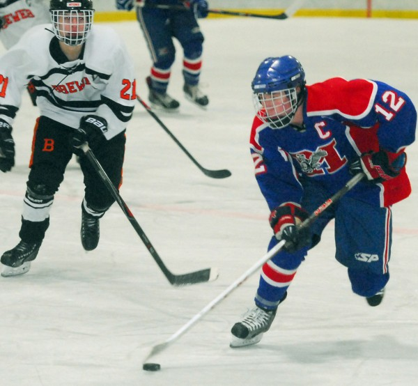 Chase Cunningham of Messalonskee High School (12), pictured in a Jan. 22 game in Brewer, has been named the Eastern Maine Class B hockey player of the year.