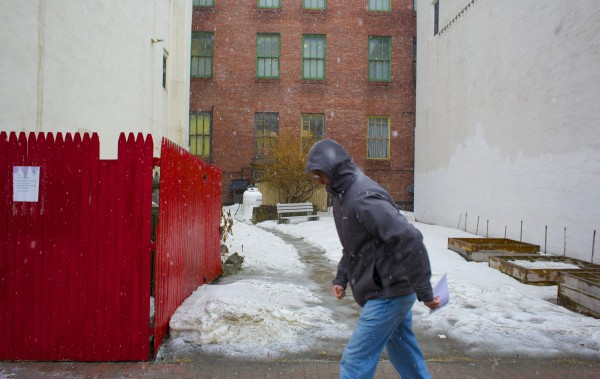 People in downtown Bangor walk through a late winter storm that started Wednesday and is expected to bring as much as 2 feet of snow to parts of Maine, according to the National Weather Service.