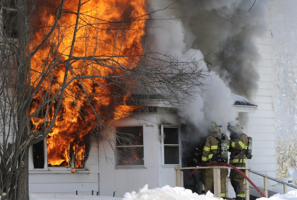 Firefighters battle the blaze at an apartment in Carmel on Tuesday.