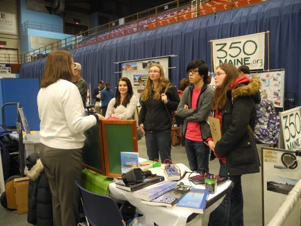 Members of the Gorham High School Green Team learn more about Unity College, known for its emphasis on sustainability science, Wednesday during a Climate Solutions Expo and Summit at the Augusta Civic Center. The high school students said they would like to implement new programs to compost food scraps and to use non-disposable silverware and trays at their school.