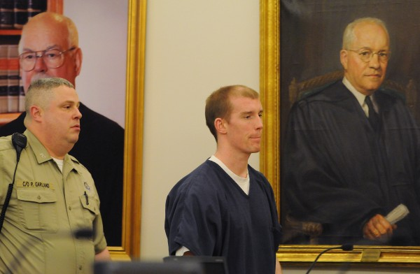 Nicholas Sexton is lead in to the courtroom at the Penobscot Judicial Center in Bangor on Wednesday for a hearing to determine if he should have a trial separate from co-defendant Randall Daluz.
