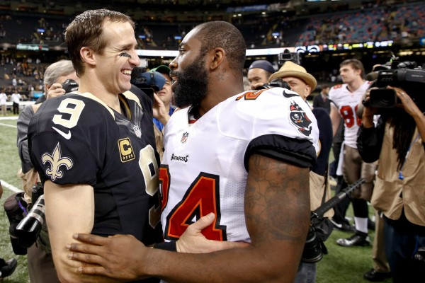 New Orleans Saints quarterback Drew Brees (left) talks with Tampa Bay Buccaneers cornerback Darrelle Revis (24) following a Saints win over the Bucs on Dec. 29, 2013 in New Orleans.