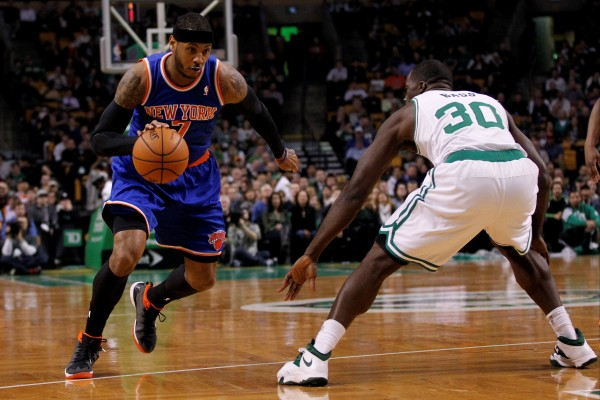 New York Knicks forward Carmelo Anthony (7) dribbles the ball as Boston Celtics forward/center Brandon Bass defends during the first quarter at TD Garden in Boston Wednesday night.